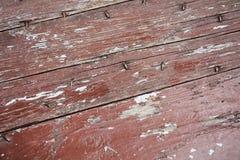 木腐朽的红色抽象背景和纹理 免版税库存照片