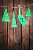 木表面上的圣诞快乐标记 免版税库存照片