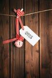 木表面上的圣诞快乐标记 库存图片