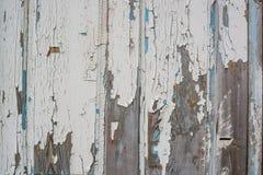 木表面上的白色破裂的绘画 免版税库存图片