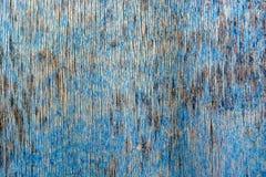 木表面上的蓝色破裂的绘画 免版税图库摄影