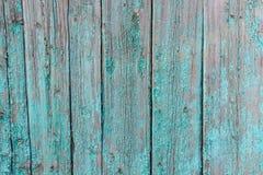 木表面上的破裂的绘画 库存照片