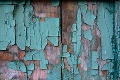 木表面上的破裂的绘画 库存图片