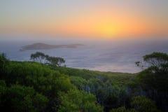 木质海岛的日落 免版税库存照片