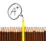 木铅笔安排与一个不同与等级A措辞的a 库存照片