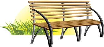 木长凳的草 免版税库存图片