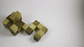 木难题立方体形状的智力 免版税库存照片