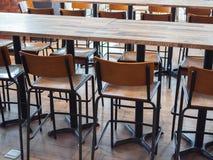木高凳和木桌行  免版税图库摄影