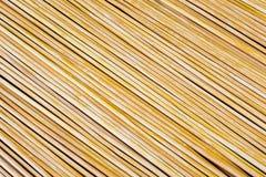 木黄色竹席子纹理摘要背景 免版税库存照片