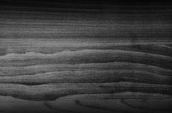 黑木头黑暗的纹理  免版税库存图片
