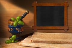 木黑板在厨房里 图库摄影