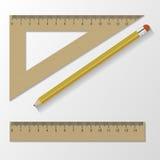 木统治者仪器和学校设备 背景查出的白色 也corel凹道例证向量 图库摄影