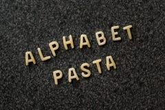 未加工的字母表面团写与信件在Granit灰色表面 库存照片