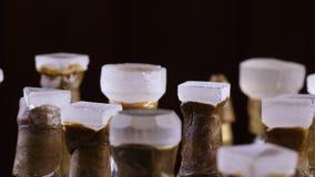 未加工的宝石处理设备 在金属dop棍子的宝石在一个在上雕琢平面的机器的一个小平面的 影视素材