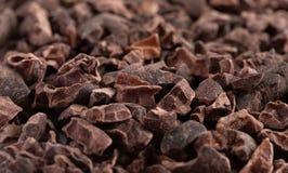 未加工的巧克力鸟嘴背景  免版税库存照片