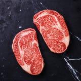 未加工的新鲜的使有大理石花纹的肉牛排Ribeye 免版税图库摄影