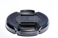 黑未打上烙印的DSLR镜头盖,隔绝在白色背景 库存照片