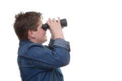 未来我们的孩子。有双筒望远镜的男孩 免版税库存照片