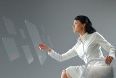 未来技术。 女孩按钮触摸屏幕接口。 库存照片