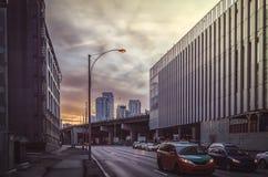 未来派都市风景在日落的多伦多 免版税库存图片