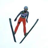未知的滑雪跳高者竞争 免版税图库摄影
