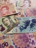 未组织起来不同的衡量单位,背景和纹理阿根廷钞票  免版税库存照片