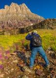 未认出的摄影师冰川国家公园 免版税图库摄影