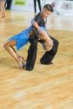 未认出的舞蹈夫妇执行WDSF波儿地克的盛大Prix-2106的青年时期2拉丁美洲的节目 免版税库存图片