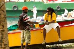 本机在贝基亚岛,石榴汁糖浆,加勒比 免版税库存图片