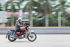 本田摩托车的在路,广州,中国人 图库摄影