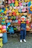 札幌,日本- 4月27,2015 :日本动画塑料面具 库存图片