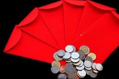 朱红色的口袋和银色矿块 免版税库存照片