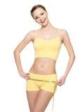 机体笑评定的妇女的健康臀部 免版税库存照片
