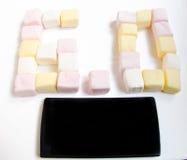 机动性和蛋白软糖与六个零的数字 免版税图库摄影