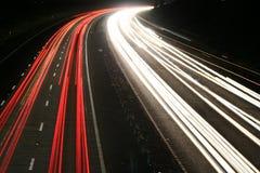 机动车路晚上 库存照片