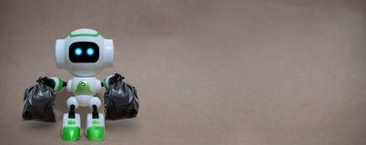 机器人举行垃圾袋技术回收环境 库存图片