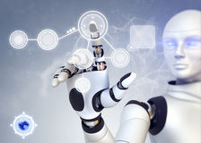 机器人和触摸屏幕 图库摄影