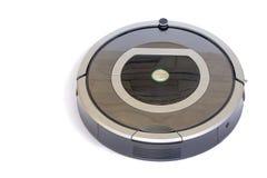 机器人学-自动化的机器人在白色bac的吸尘器 免版税库存图片