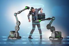 机器人胳膊被操作的商人 库存照片