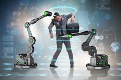 机器人胳膊被操作的商人 免版税图库摄影