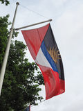 杀冠雉者安提瓜和巴布达Barbudan旗子  免版税库存照片