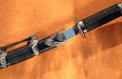 杀害短的剑 免版税库存图片