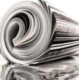杂志卷起了 免版税库存图片