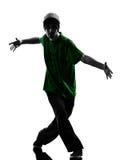 年轻杂技断裂舞蹈家breakdancing的人剪影 库存照片