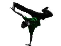 年轻杂技断裂舞蹈家breakdancing的人剪影 免版税库存图片