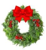 从杉木和云杉红色丝带的圣诞节花圈鞠躬 库存照片