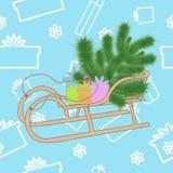 杉树和礼物在雪撬 库存照片