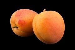 杏子在balck的果子特写镜头 免版税图库摄影