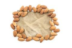 杏仁、小组杏仁和葡萄酒织品棉花在白色 免版税库存图片