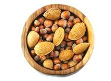 杏仁和坚果顶视图在一手工制造木 库存图片